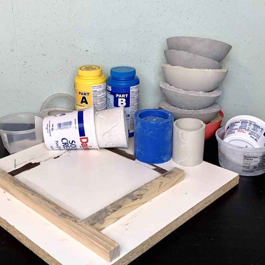 various molds for concrete crafts- plastic containers, melamine, silicone and concrete pieces