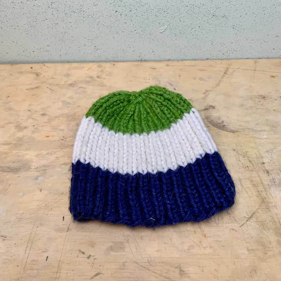 knit winter hat on table for molding concrete