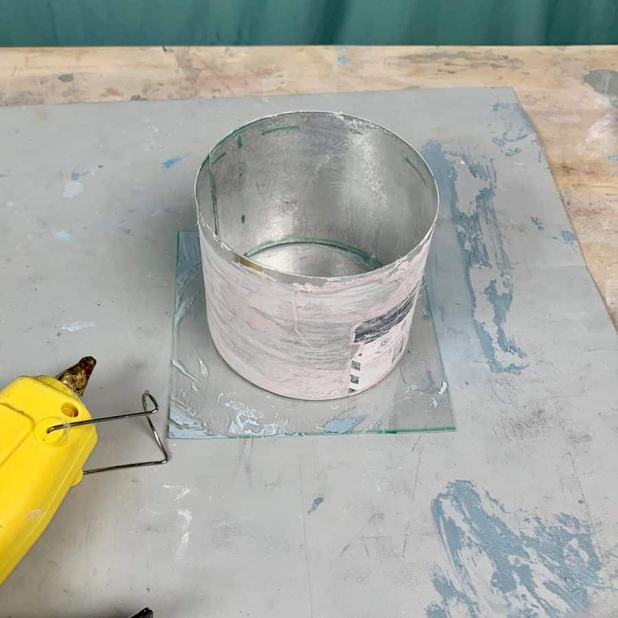 aluminum flashing curled into round shaped and taped