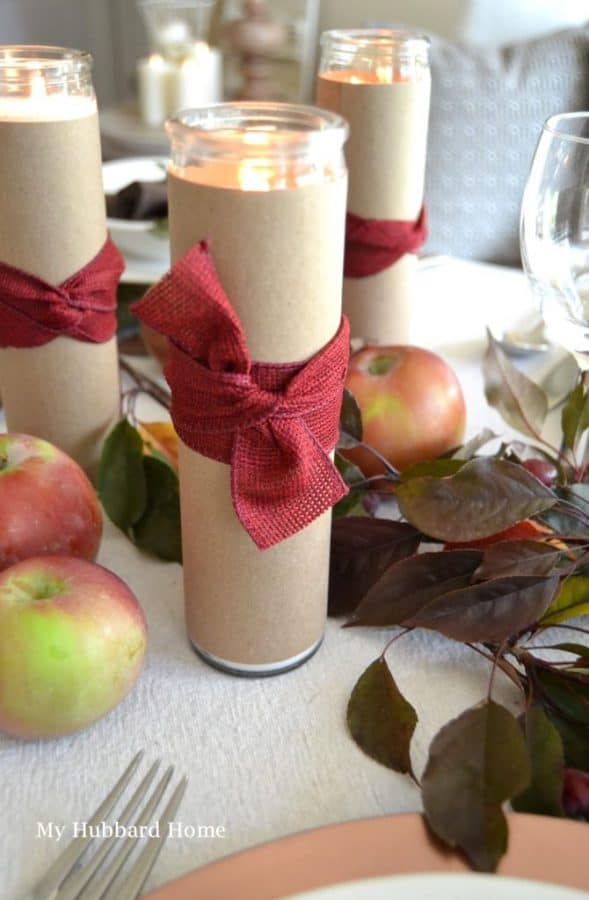 budget candles wrapped with kraft paper and ribbon - decorating table