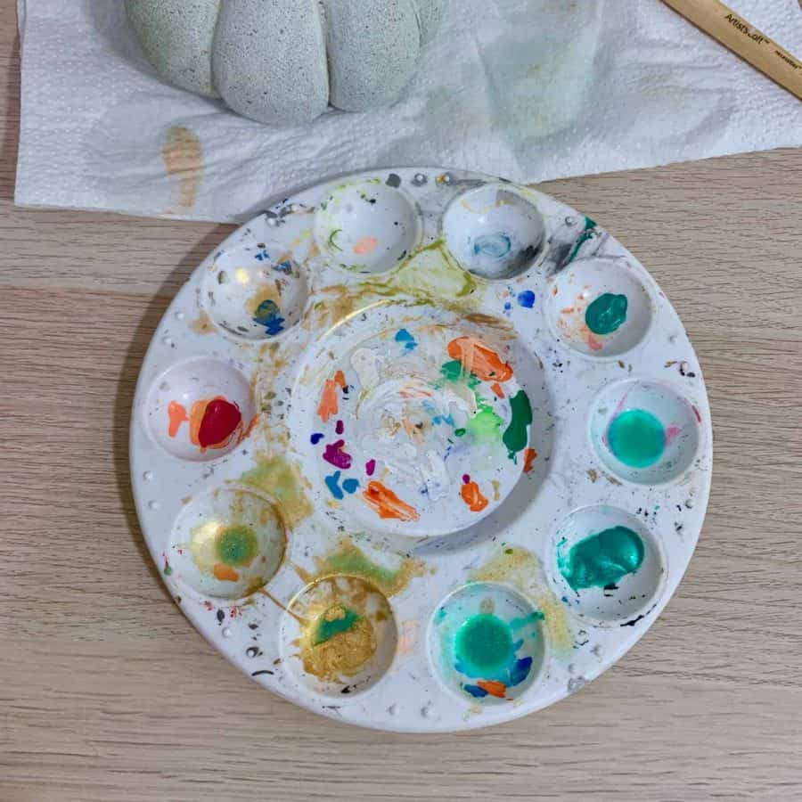 paint tray with shimmery paints watered down