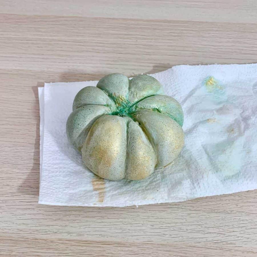 more paint applied around DIY cement pumpkin