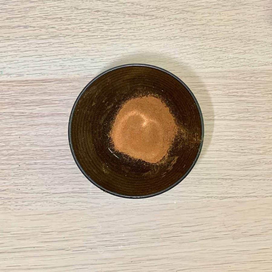 cinnamon in bowl for dipping glued pumpkin stalk
