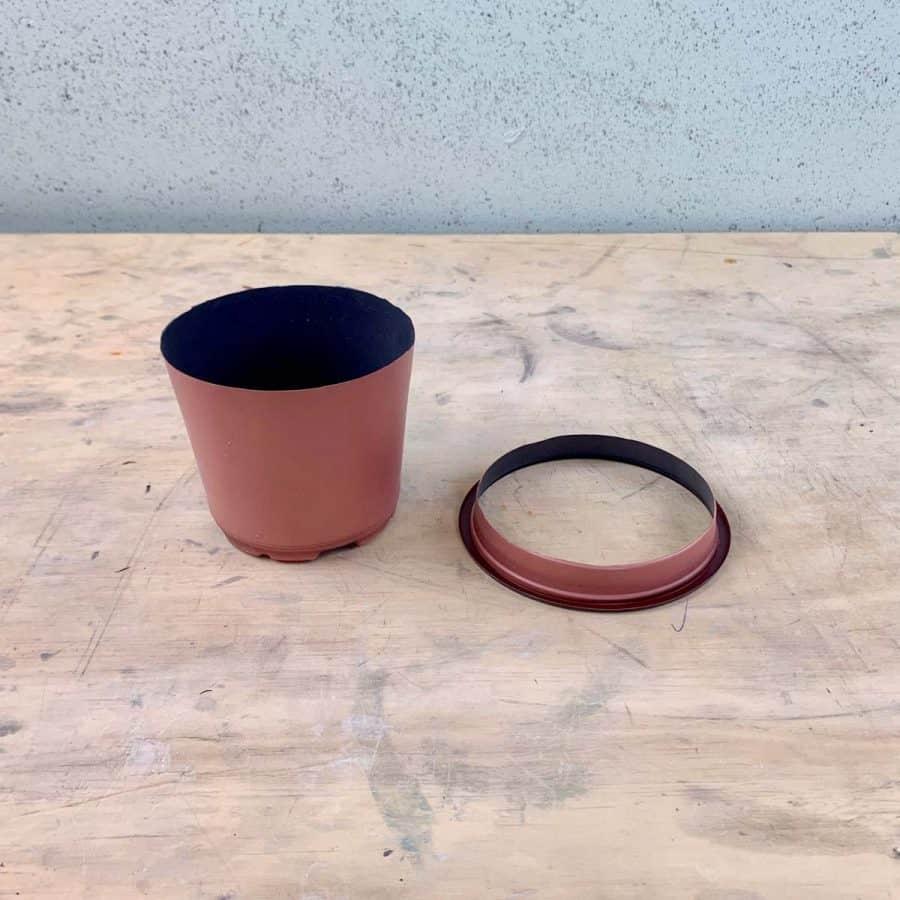 plastic pot with top cut off