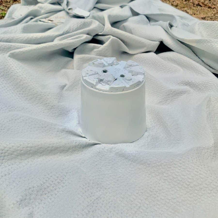spray painted plastic pot on tarp