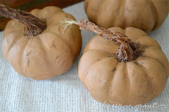 3 fall crafts which are a group of orange painted pumpkins with sisal stem