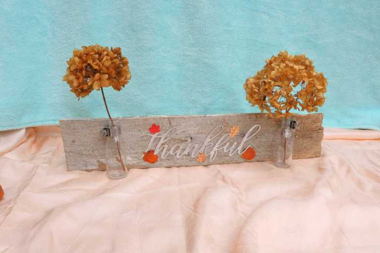 rustic wood thankful sign craft- with small bottles flanking word