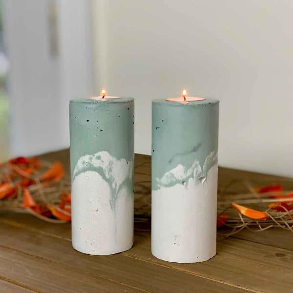 two marbled green DIY concrete pillar candle holders