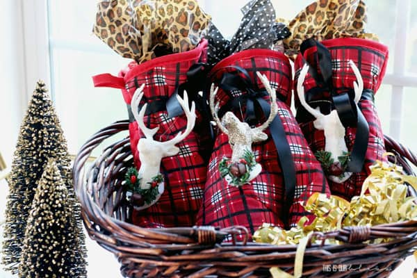 plaid oven mitts with reindeer on them. wrapped to look like gifts