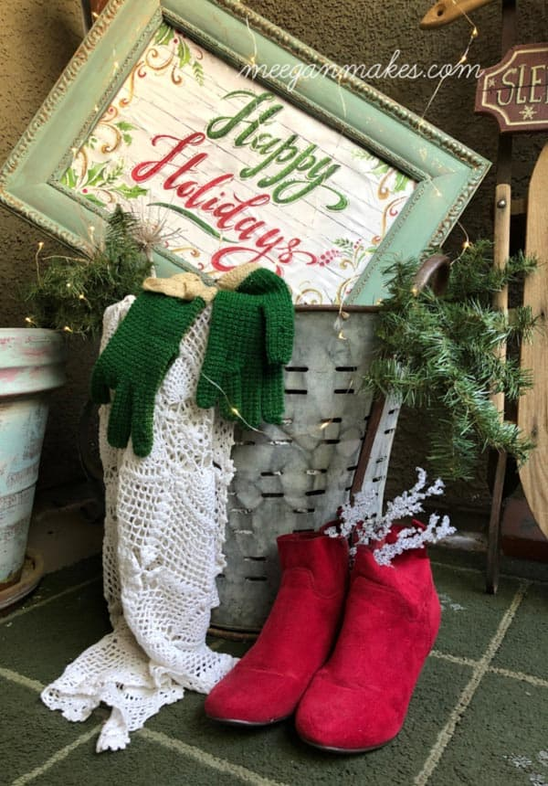 wood frame with a gift wrap bag that says happy holidays. bag is decoupaged and inside frame