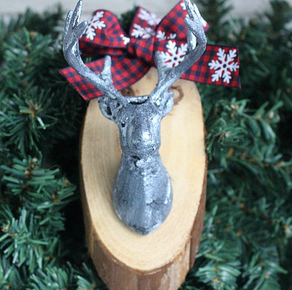 wood plaque with silver reindeer head attached