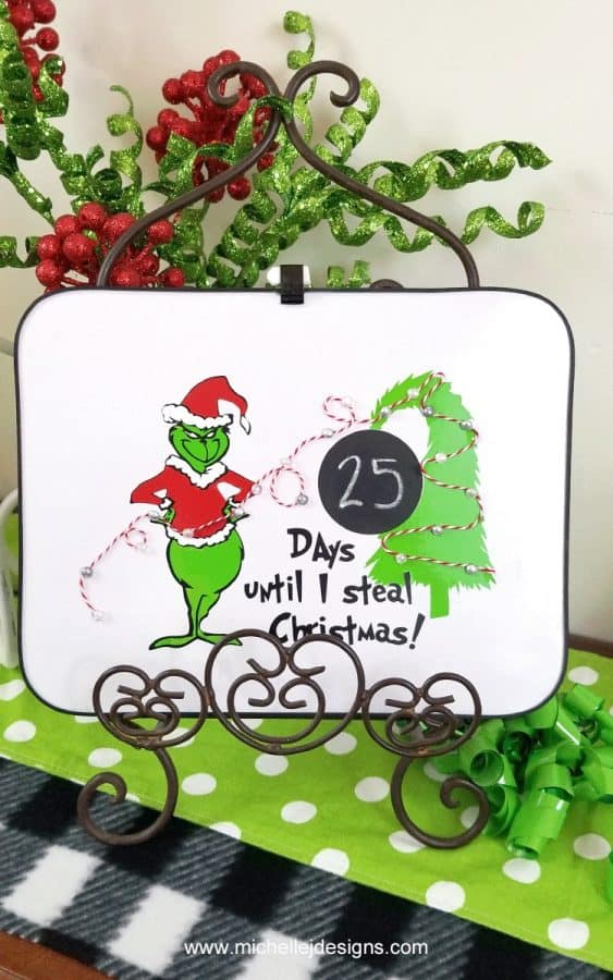The Grinch on a white erase board is a decal made of of vinyl and has circle with day numbers on it showing countdown until christmas