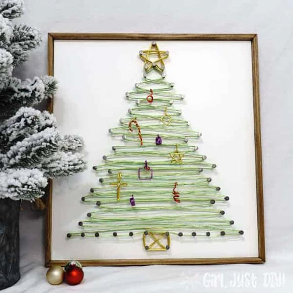 frame with string art of a christmas tree, but uses green wire instead