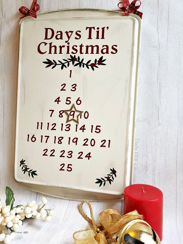 calendar dates painted onto back of cookie sheet and painted with antique look