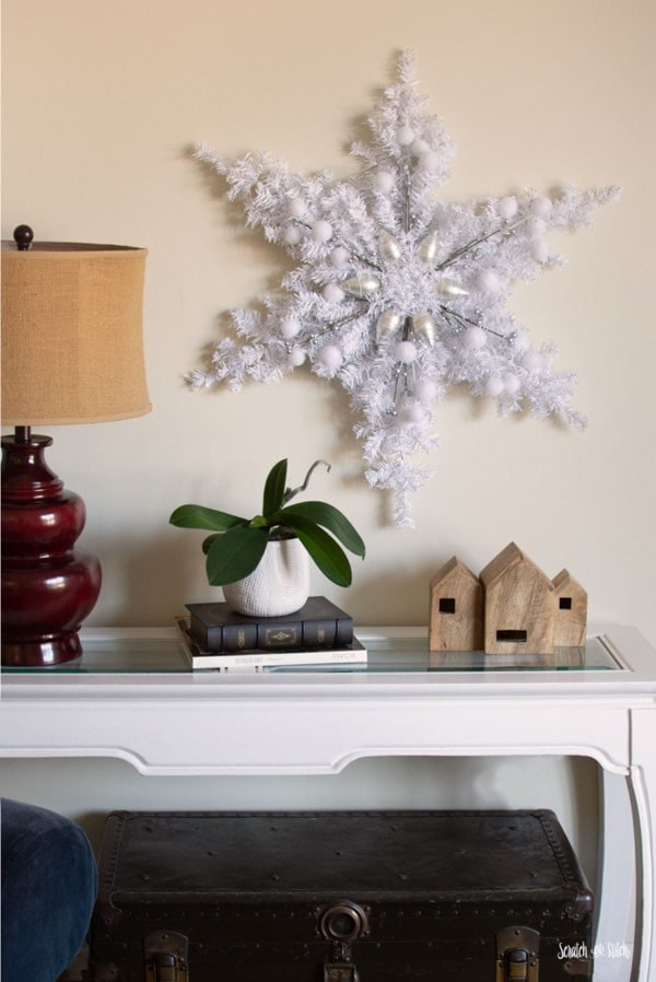 giant white star diy wreath made from small faux white christmas tree from dollar store
