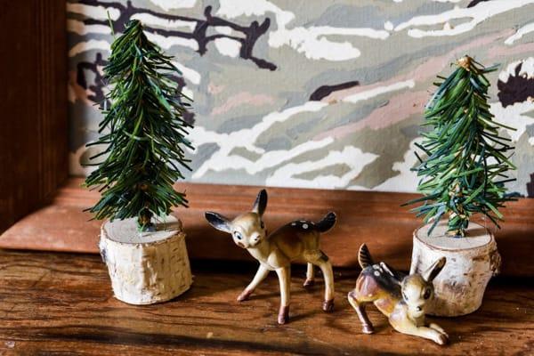 mini christmas trees with birch stump bases