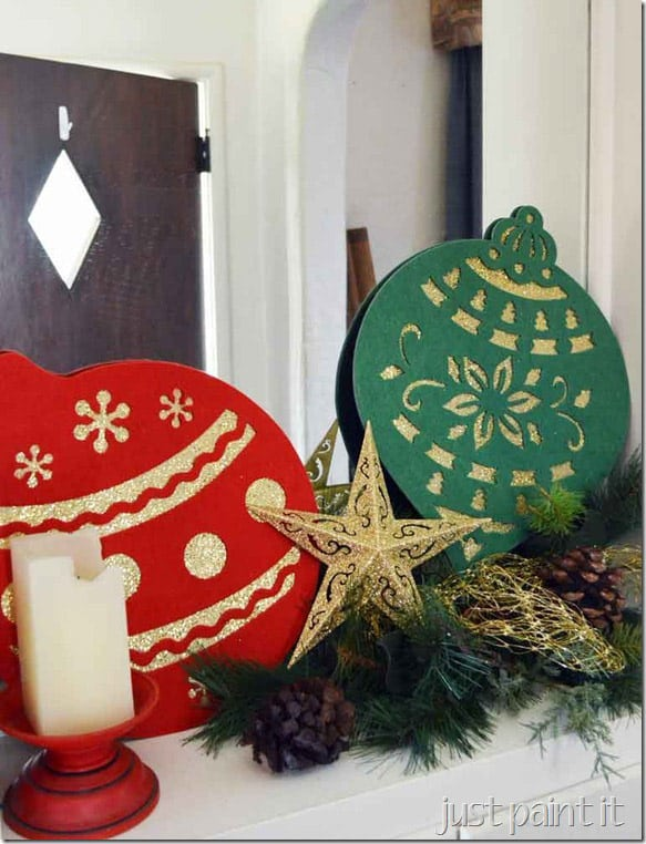 diy large ornaments with cutouts that are gold glittered