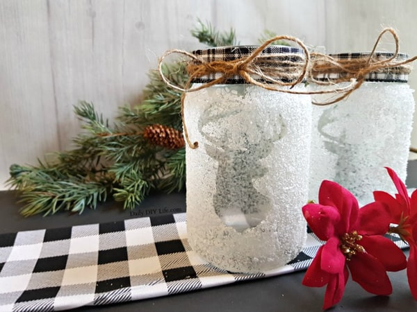 snow covered mason jars with reindeer design