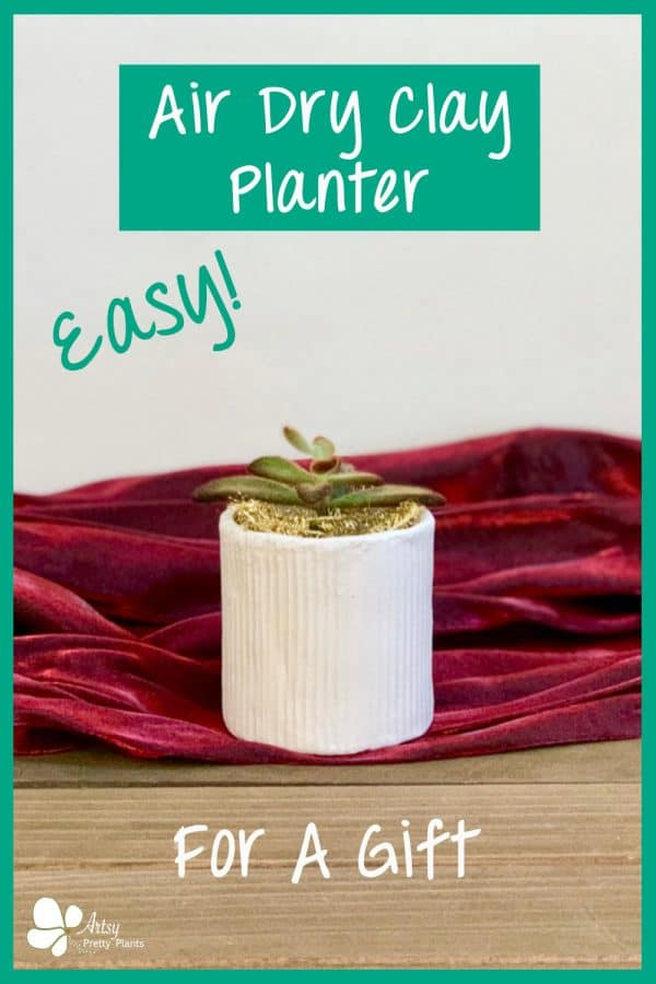 air dry clay planter on christmas red fabric