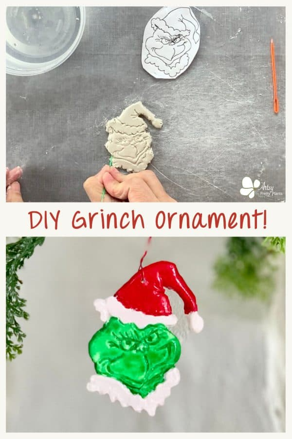 clay diy grinch ornament hanging from christmas tree branch
