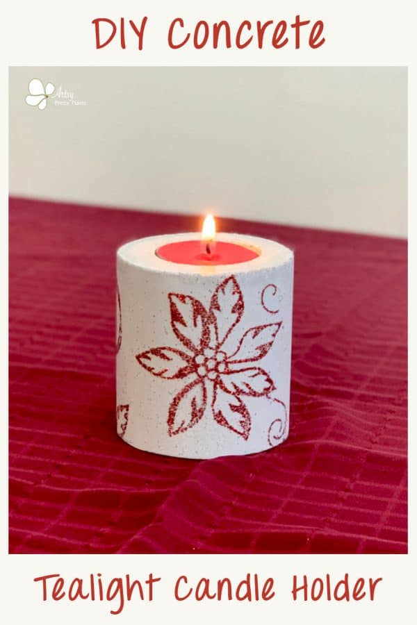 concrete candle holder christmas gift. white concrete with poinsettia design on it