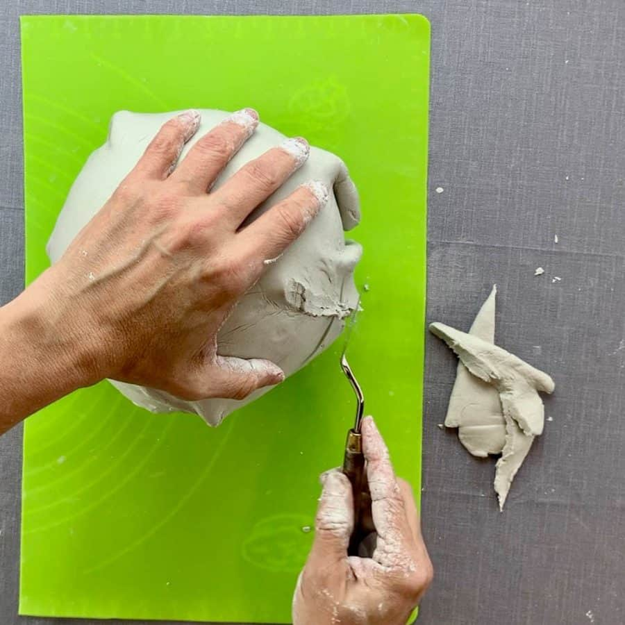 knife smoothing trimmed clay