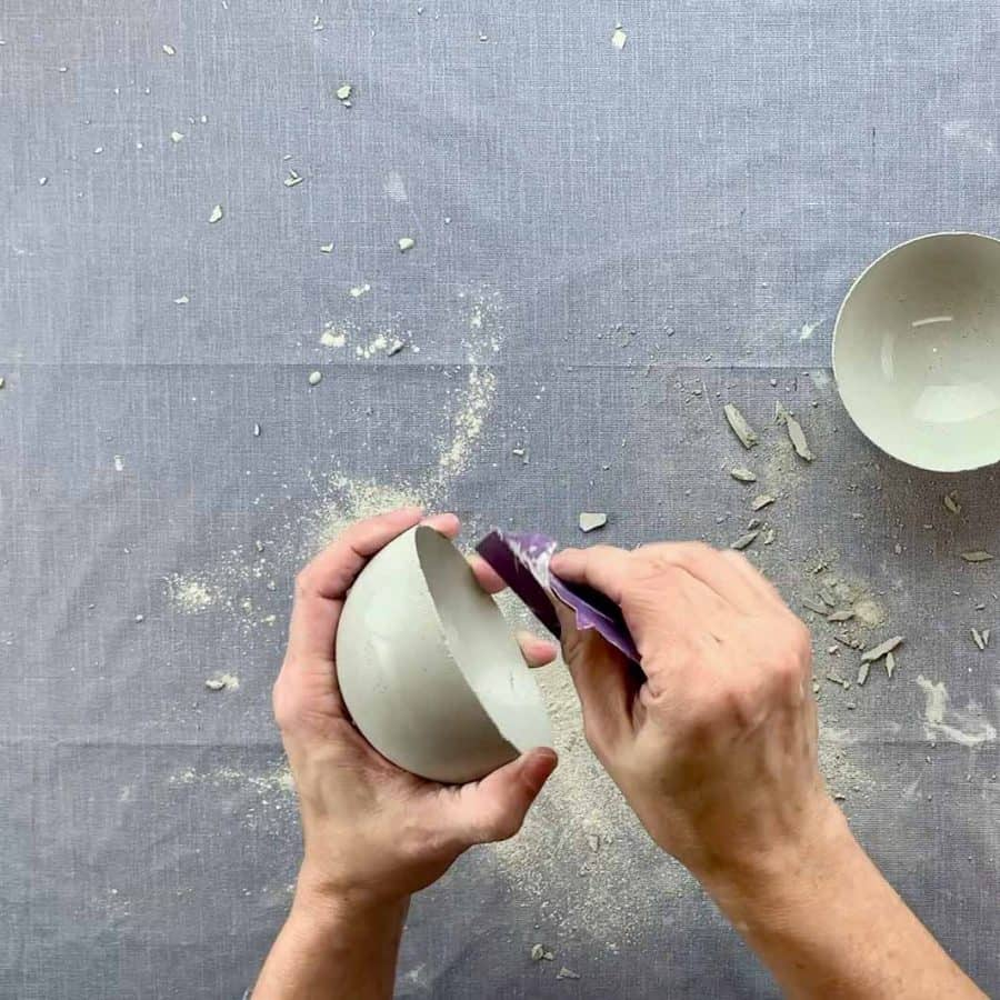 sanding edge of diy concrete bowl