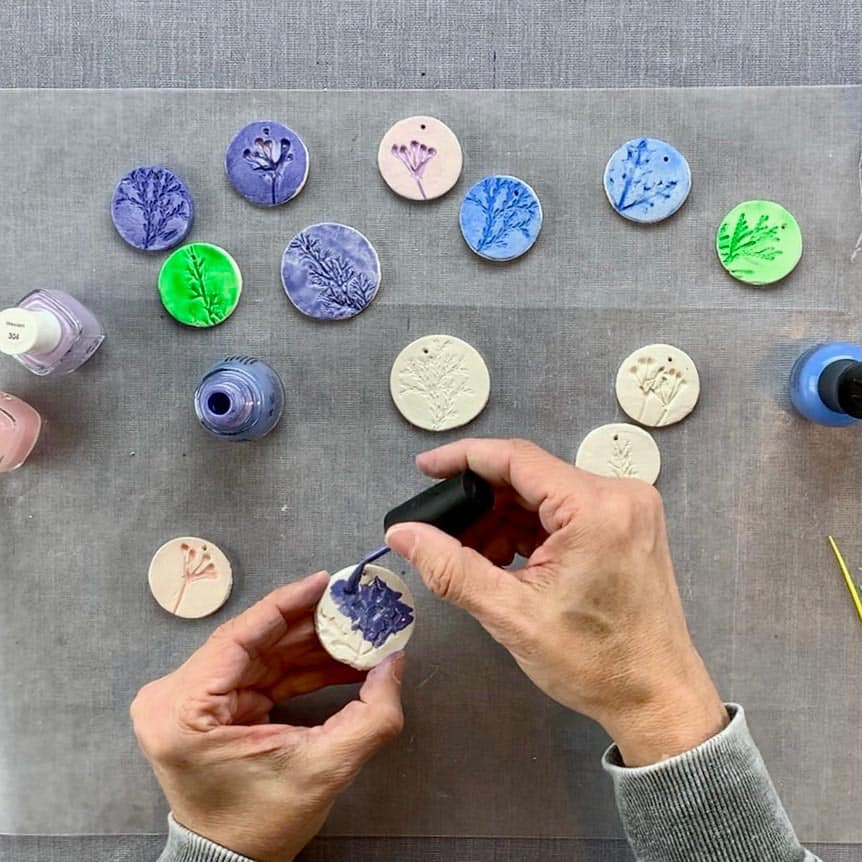 diy nature ornaments with nail polish brushing on top of clay
