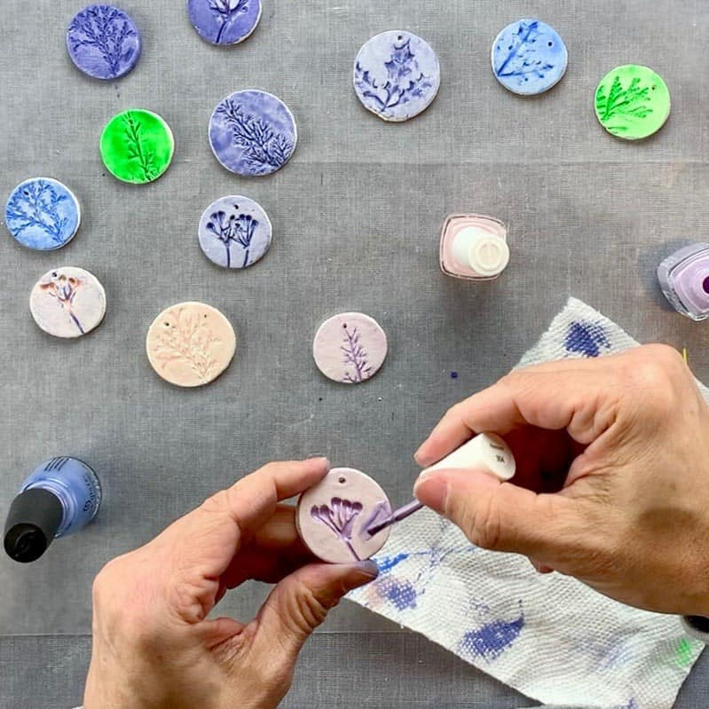 diy nature ornaments being painted with nail polish