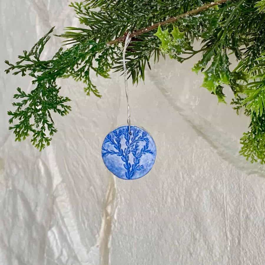 diy nature ornament hanging from christmas tree branch