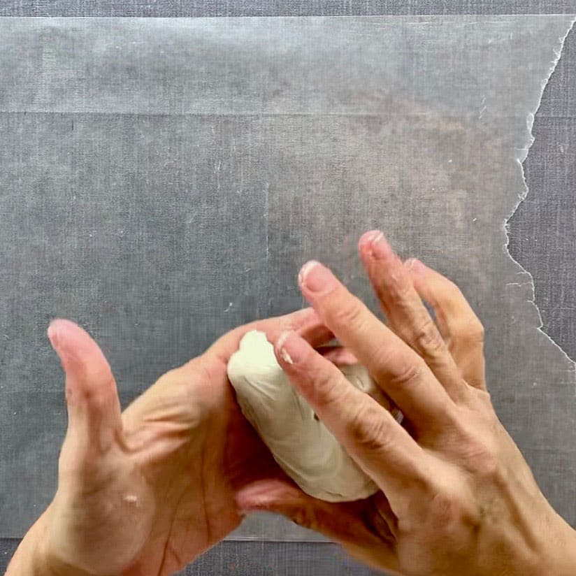 hands kneading air dry clay