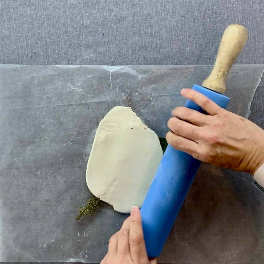 rolling pin rolling clay