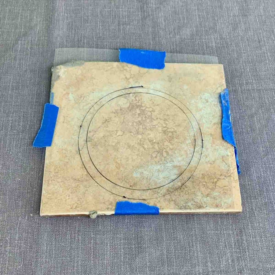 two circles marked on tile with acetate