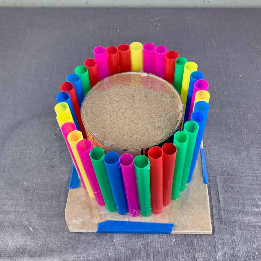 straws glued to make circle to act as outer mold -inner mold of sand tube inside