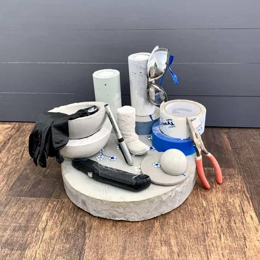 supplies needed for making concrete crafts stacked up in piles on top of concrete crafts