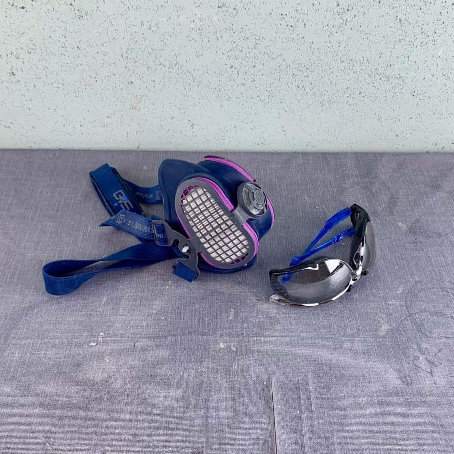 safety glasses and respirator mask for concrete safety
