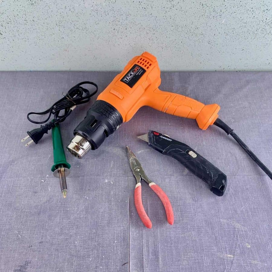 demolding tools for concrete crafts on table- heat gun, pliers, heat tool and utility knife