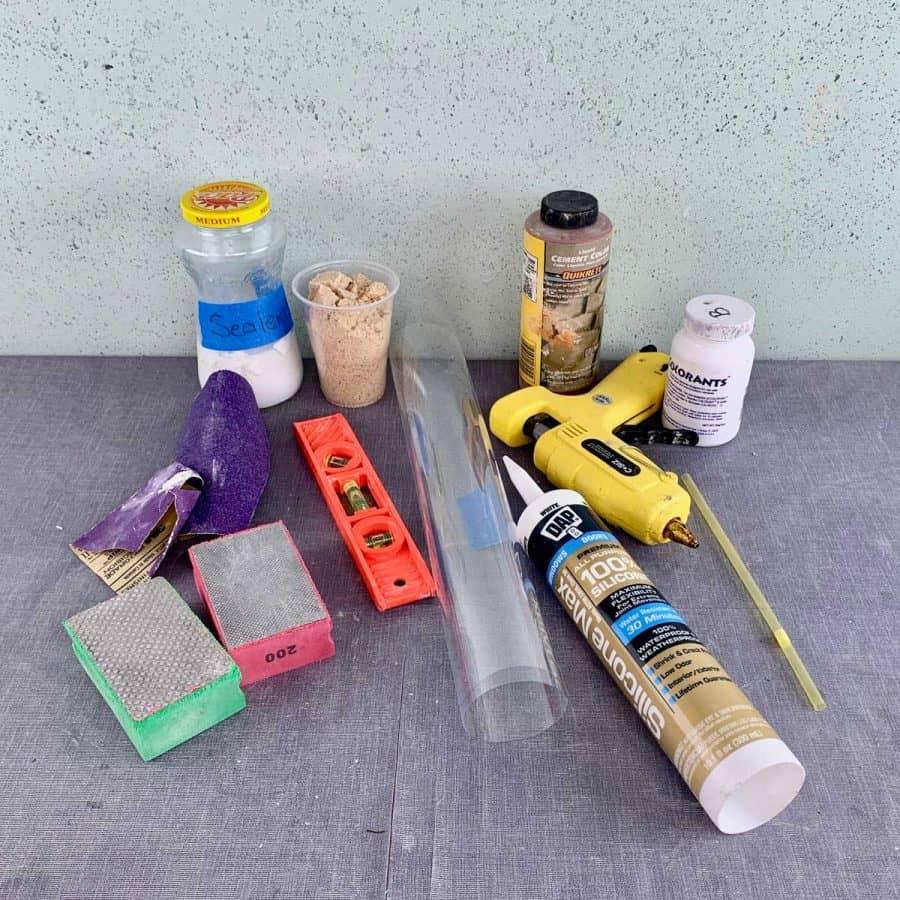 items needed for making concrete crafts- sand paper, caulk, concrete sealer, cement pigments