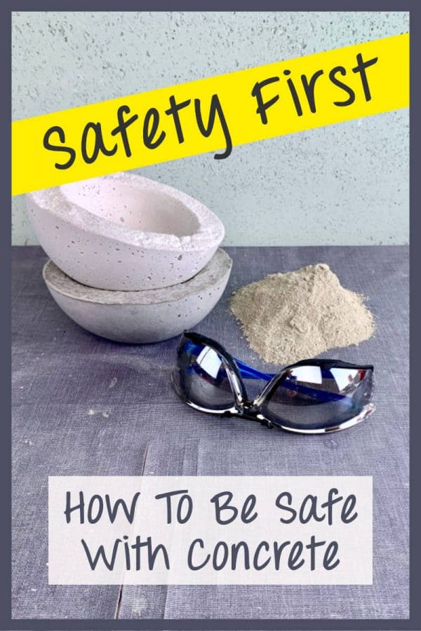safety glasses, cement mix and concrete crafts on table with yellow warning tape saying safety first
