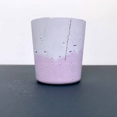 purple marbled quick-made concrete planter with hairline crack down side