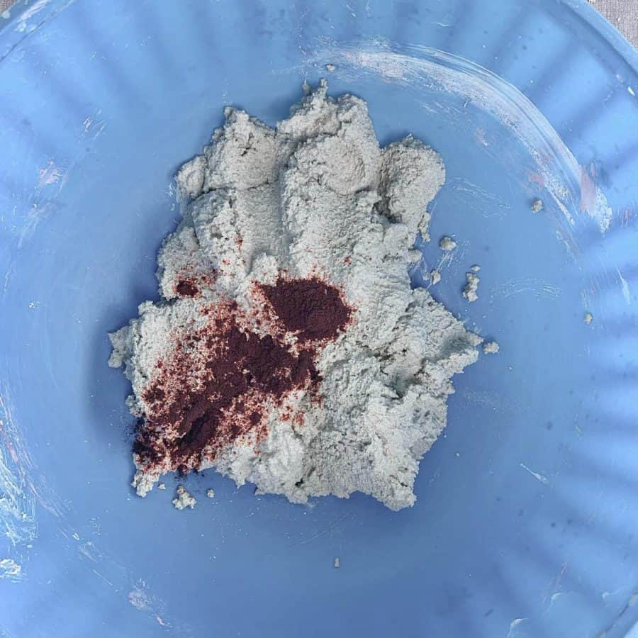 white mortar mix with powdered dye on top