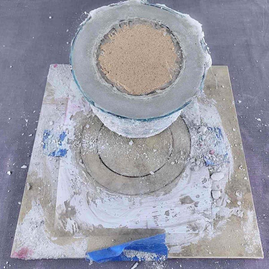 mold upside down showing sand still inside inner mold