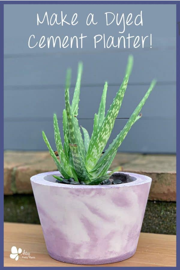 marbled dyed purple and white concrete planter with plant inside