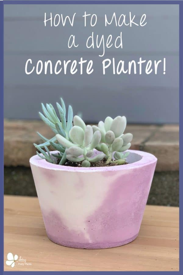 marbled purple and white cement planter with plant inside
