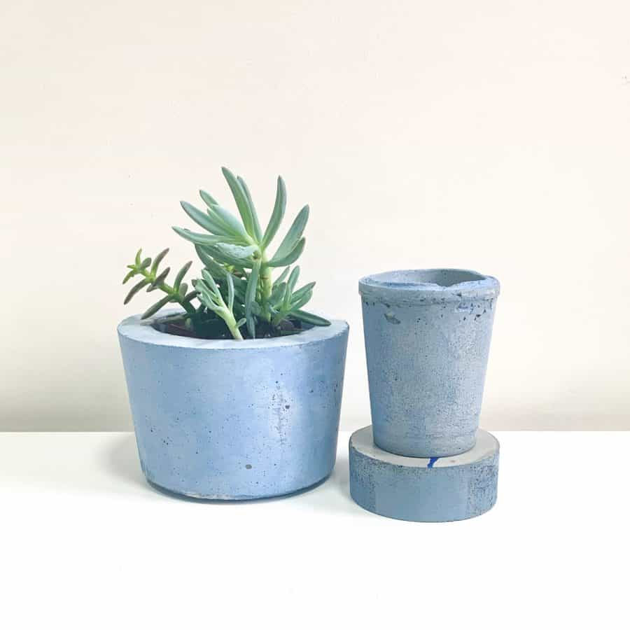 two planters side by side, one is brighter blue the other is more muted blue