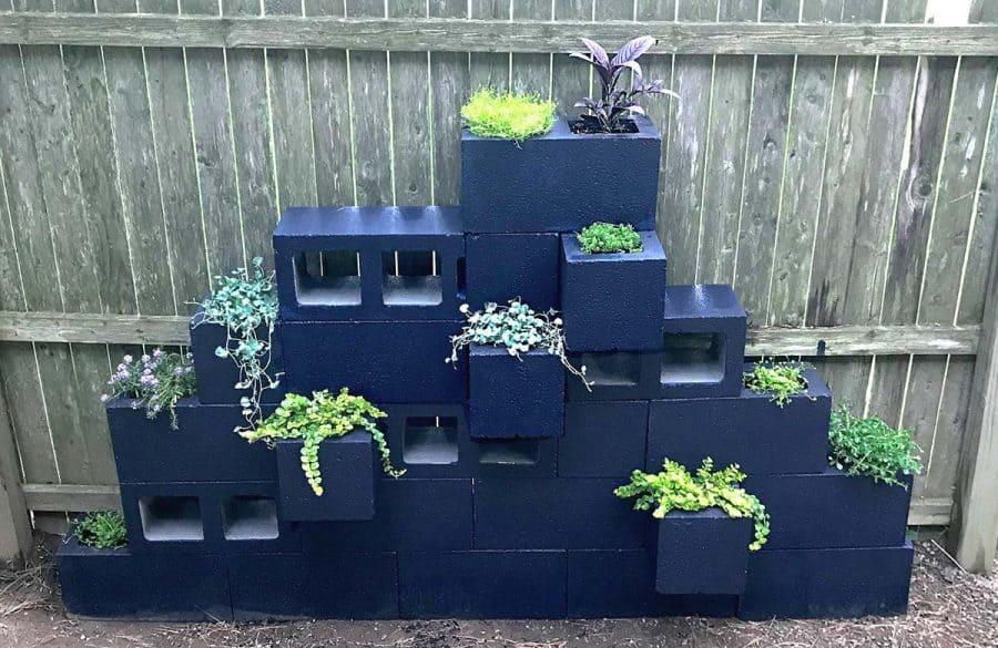 Gorgeous Cinder Block Planters Tutorial A cinder block planter sculpture! Paint and stack cinder blocks, add plants to make a fantastic vertical planter.