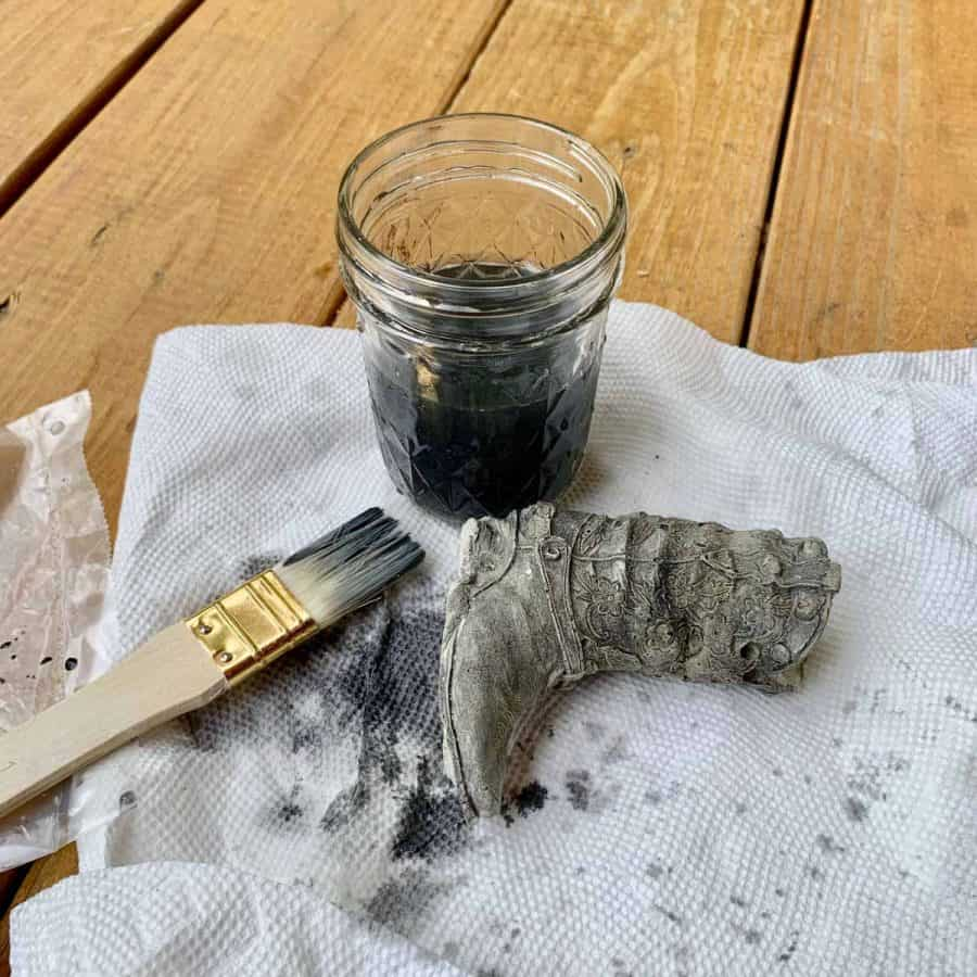 boot with watered down black paint and brush with grey water in jar