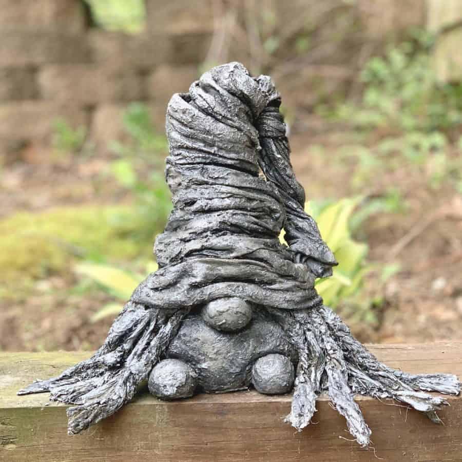 gnome sitting on wood log