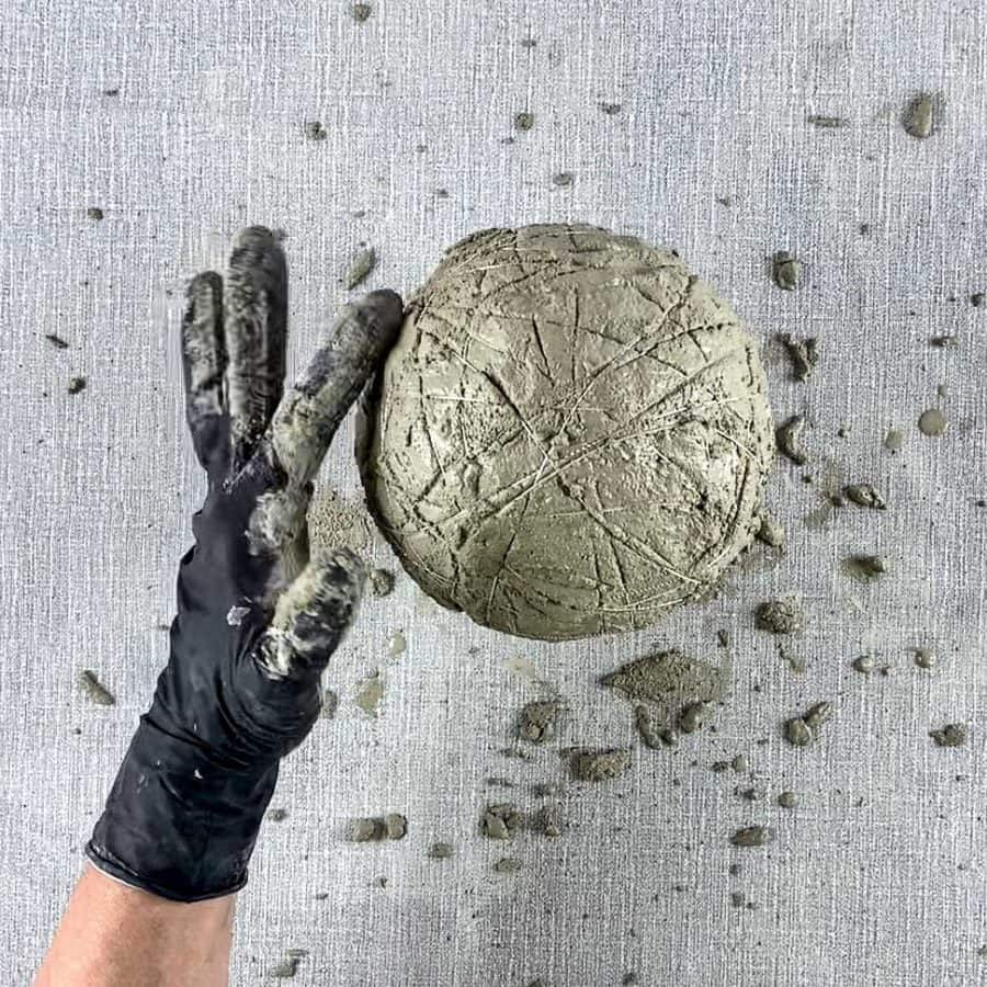 finger pressing side of cement and cord