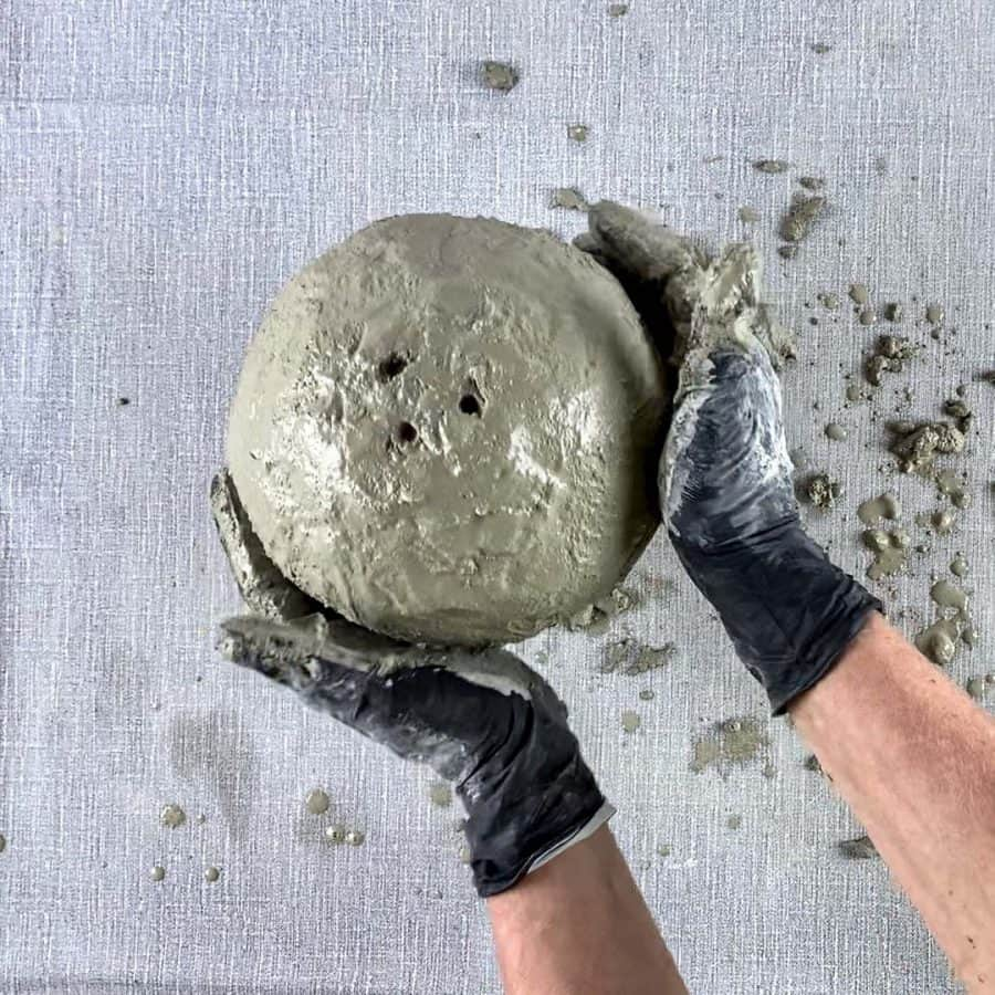 smoothing sides of cement